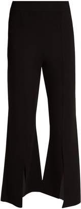 Stella McCartney Asymmetric-hem cropped fine-knit trousers