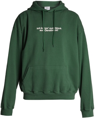 VETEMENTS Hooded cotton-blend sweatshirt $890 thestylecure.com