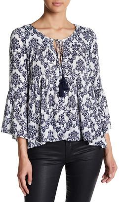 En Creme Hi-Lo Bell Sleeve Shirt $42 thestylecure.com