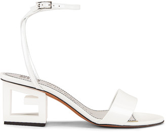 Givenchy Patent Leather Triangle Heel Strap Sandals in Off White | FWRD