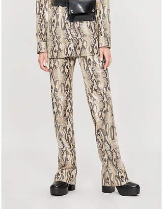 MSGM High-rise flared faux-python shirt