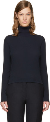 Thom Browne Navy Long Sleeve Turtleneck $390 thestylecure.com