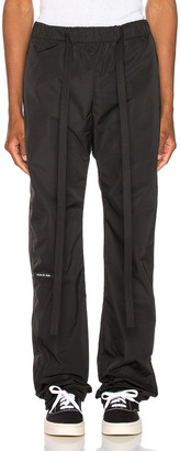 Fear Of God Baggy Nylon Pant in Black | FWRD