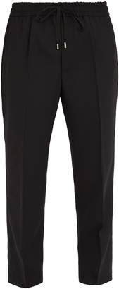 Gucci Tapered-leg mid rise wool track pants