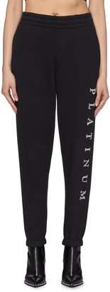 Alexander Wang 'Platinum' slogan textured print jogging pants