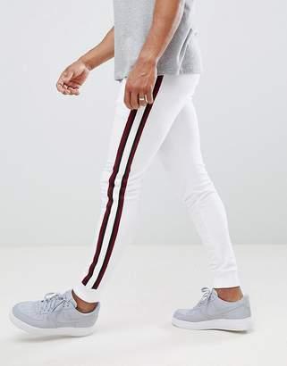 Asos DESIGN super skinny jogger in white with side stripes