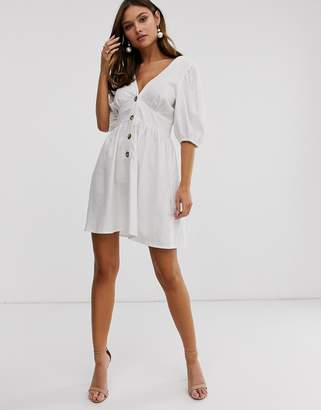 Asos Design DESIGN button through linen mini dress with cross back