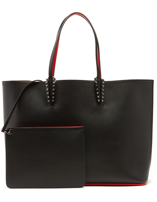 CHRISTIAN LOUBOUTIN Cabata spike-embellished leather tote $1,250 thestylecure.com