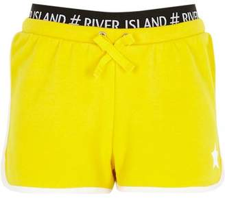 River Island Girls yellow RI waistband star runner shorts