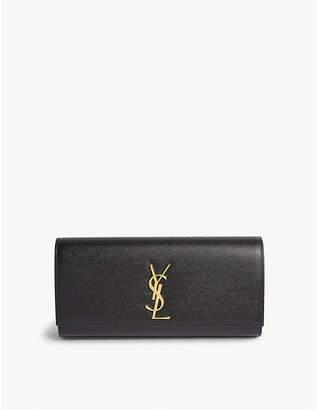 Saint Laurent Black and Gold Cassandre Leather Clutch Bag