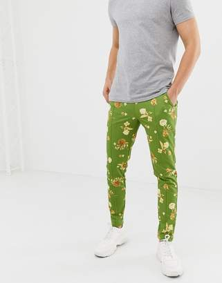 Asos DESIGN skinny joggers in retro track fabric with floral print in green