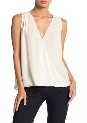Collective Concepts Surplice Sleeveless High/Low Blouse