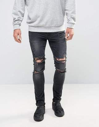 Asos Super Skinny Jeans With Mega Rips In Washed Black