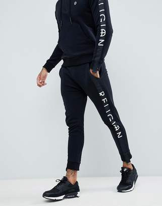 Religion skinny fit pants with leg taping in black