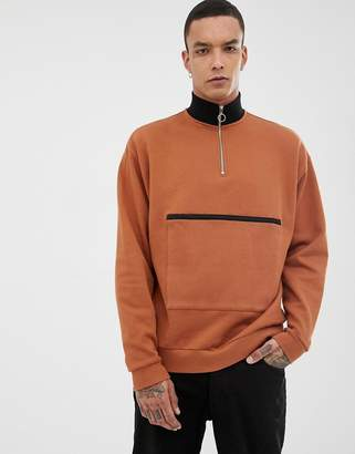 Asos DESIGN sweatshirt with half zip and map pocket in brown