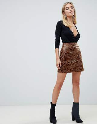 PrettyLittleThing leather look mini skirt in leopard