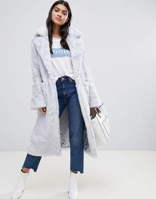 Glamorous belted faux fur coat