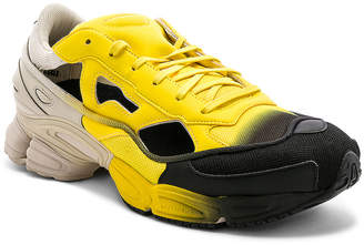 Adidas By Raf Simons Replicant Ozweego Sneaker in Yellow & Black | FWRD