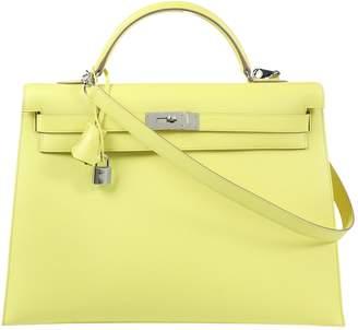 3fd61b8852 Hermes Yellow Leather Handbags - ShopStyle