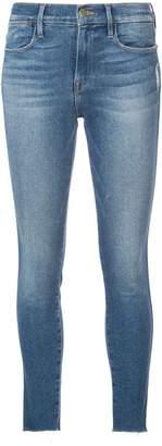 Frame skinny frayed cuff jeans