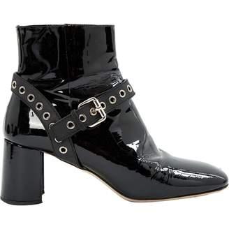 Miu Miu Patent leather buckled boots