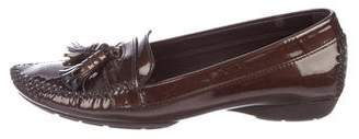 Stuart Weitzman Tassel-Accented Patent Leather Loafers