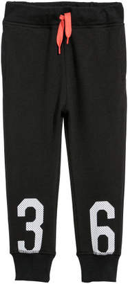 H&M Joggers with Printed Design - Black