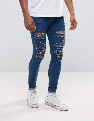 Criminal Damage Super Skinny Ripped Jeans In Mid Wash