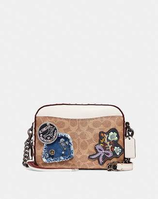 Coach Camera Bag In Signature Canvas With Patches And Border Rivets