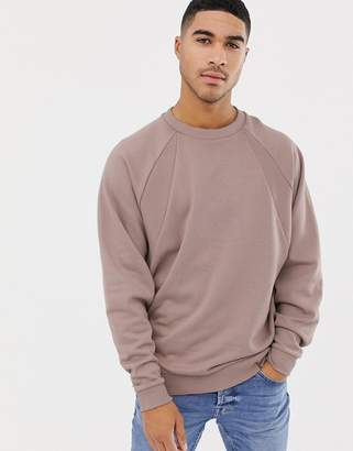 Asos DESIGN oversized sweatshirt with rib detail in dusty pink