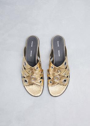 Proenza Schouler metallic gold grommet strap slide $595 thestylecure.com
