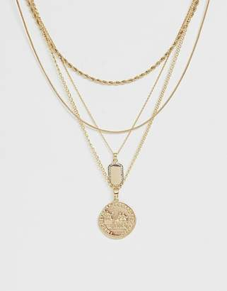 Asos Design DESIGN multirow necklace with worn coin and crystal detail tag pendants in gold