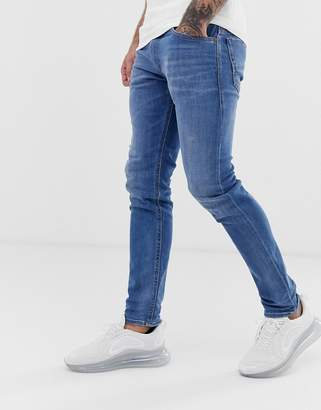 42a917d3 Diesel Thommer stretch slim fit jeans in 083AX light wash