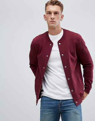 Asos DESIGN jersey bomber jacket in burgundy with poppers