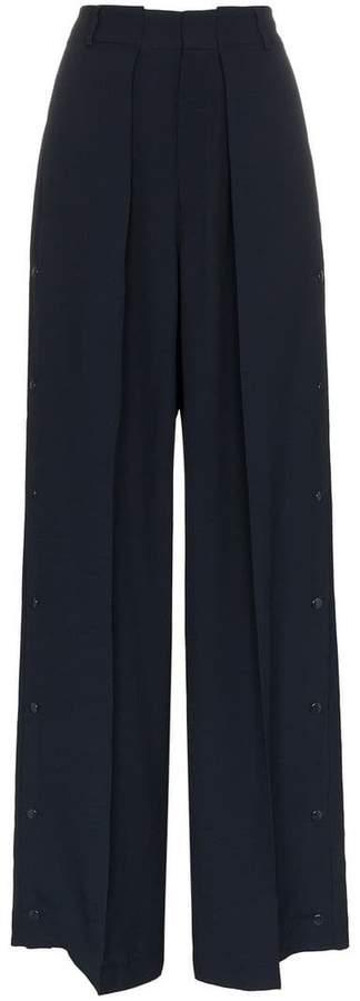 Buy Bertilla wide leg buttoned cuff trousers!