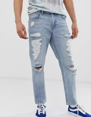 be3e8ec1e6 Asos Design DESIGN classic rigid jeans in vintage light wash blue with  heavy rips