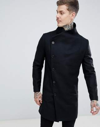 Religion funnel neck coat in black