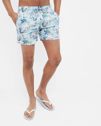 Floral and parrot print swim shorts $105 thestylecure.com