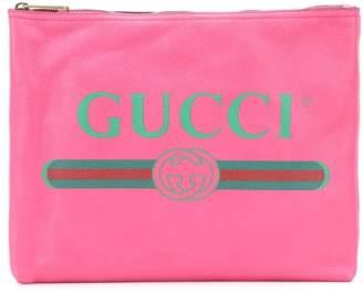 Gucci Printed leather clutch