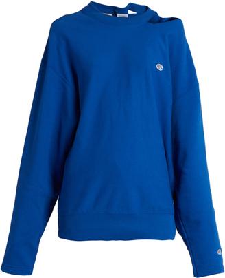 VETEMENTS X Champion oversized cotton-blend sweatshirt $740 thestylecure.com