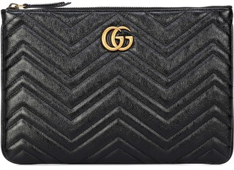 f5e12b7fa8f5cf Gucci GG Marmont quilted leather clutch