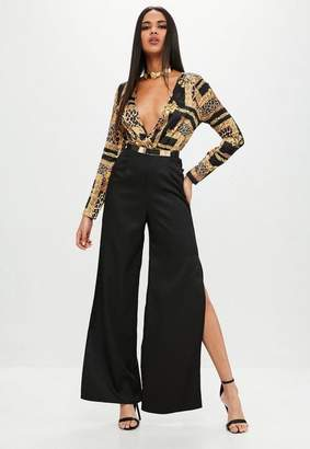 11d00010e44 Missguided Printed Wrap Front Long Sleeve Jumpsuit