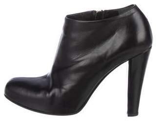 Miu Miu Leather Round-Toe Ankle Booties