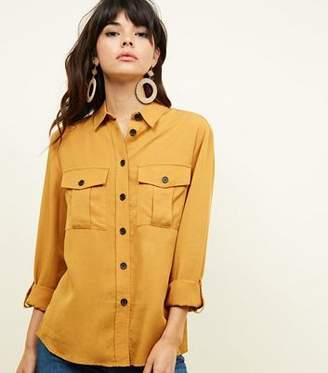 5e933500be New Look Mustard Pocket Front Dip Hem Shirt