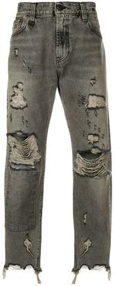 R 13 distressed patch jeans