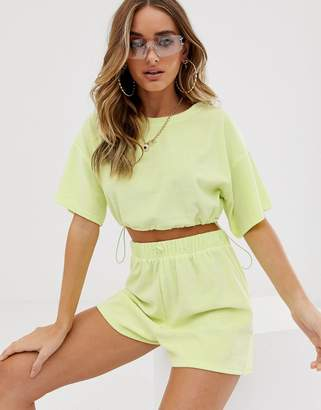 Asos Design DESIGN jersey towelling beach shorts with bungee ties in washed neon two-piece