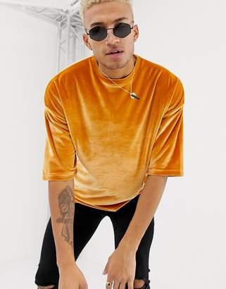 Asos DESIGN oversized t-shirt in velour in gold