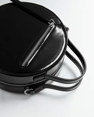 Express Circle Patent Crossbody Bag