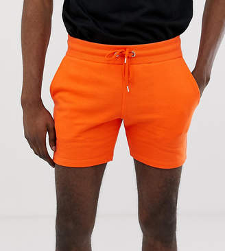 Asos Design DESIGN Tall jersey skinny shorts in shorter length in orange