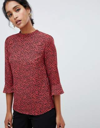Oasis blouse with flute sleeves in red leopard print